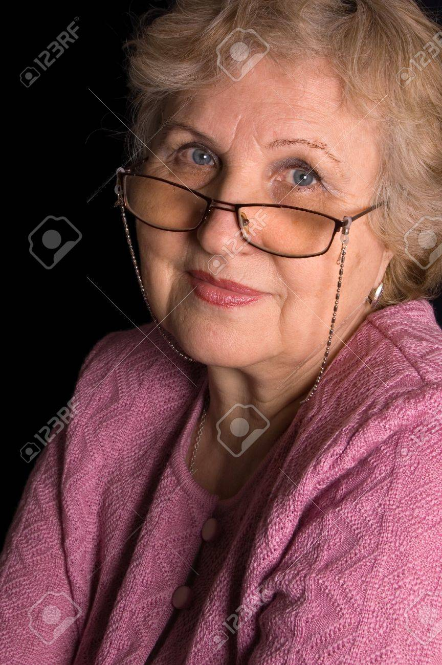 The elderly woman on black background Stock Photo - 8926302