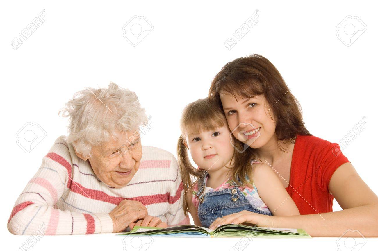 The grandmother with the grand daughter read the book Stock Photo - 9036022