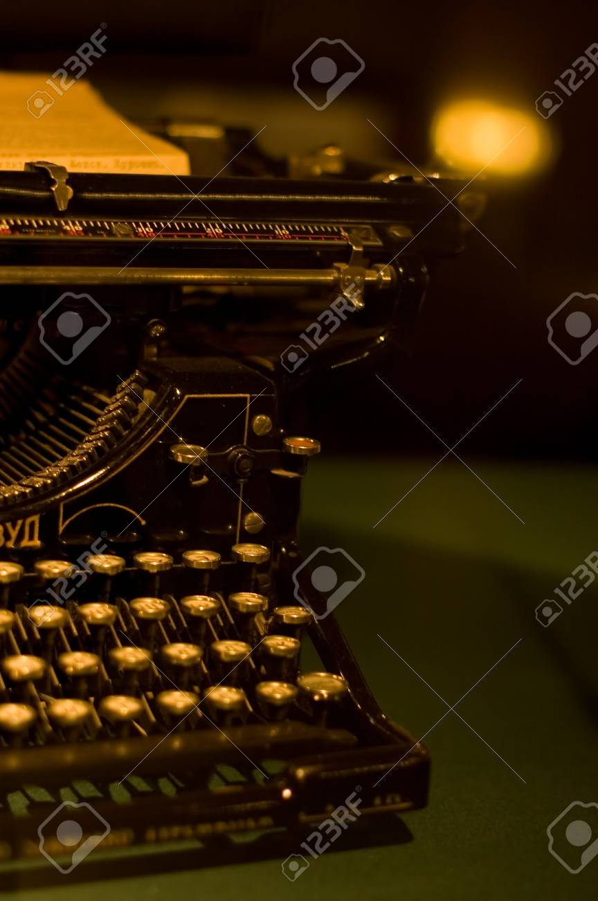 Old typewriter on an ancient table as a background Stock Photo - 9412812