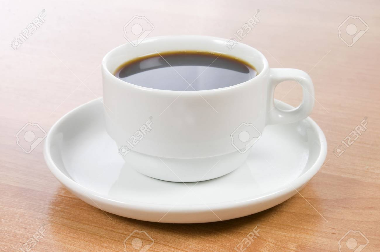 Cup of black coffee on a wooden table Stock Photo - 9545485