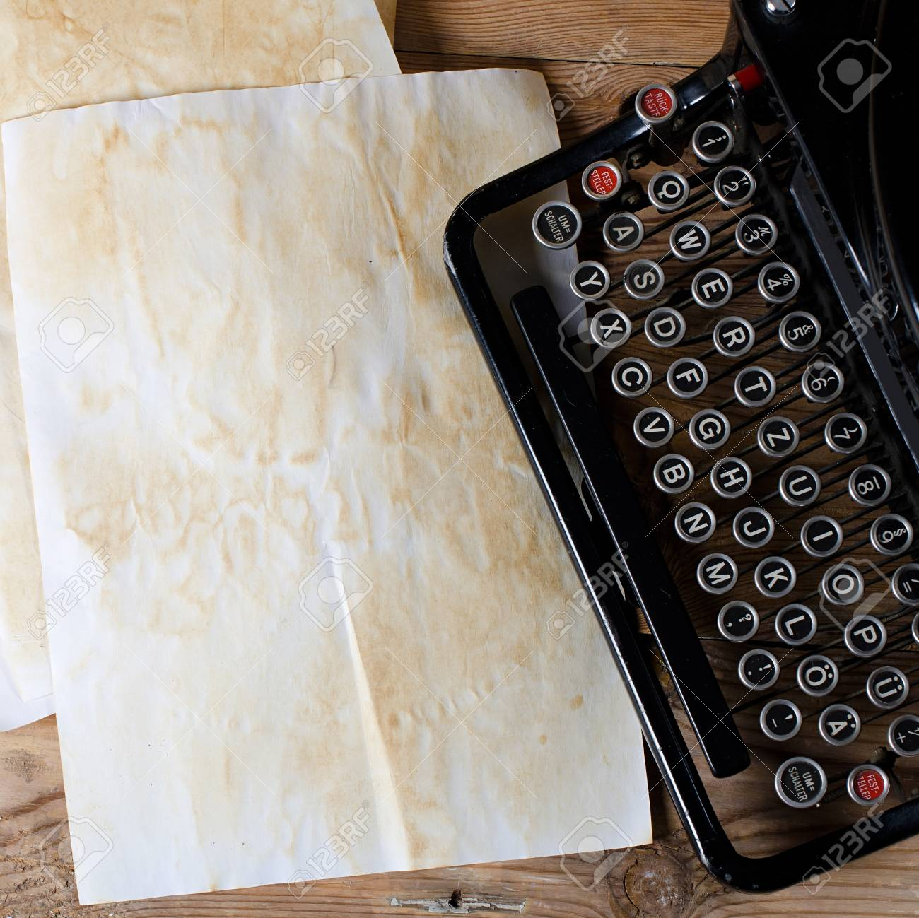 The old paper on a wooden surface Stock Photo - 10985053