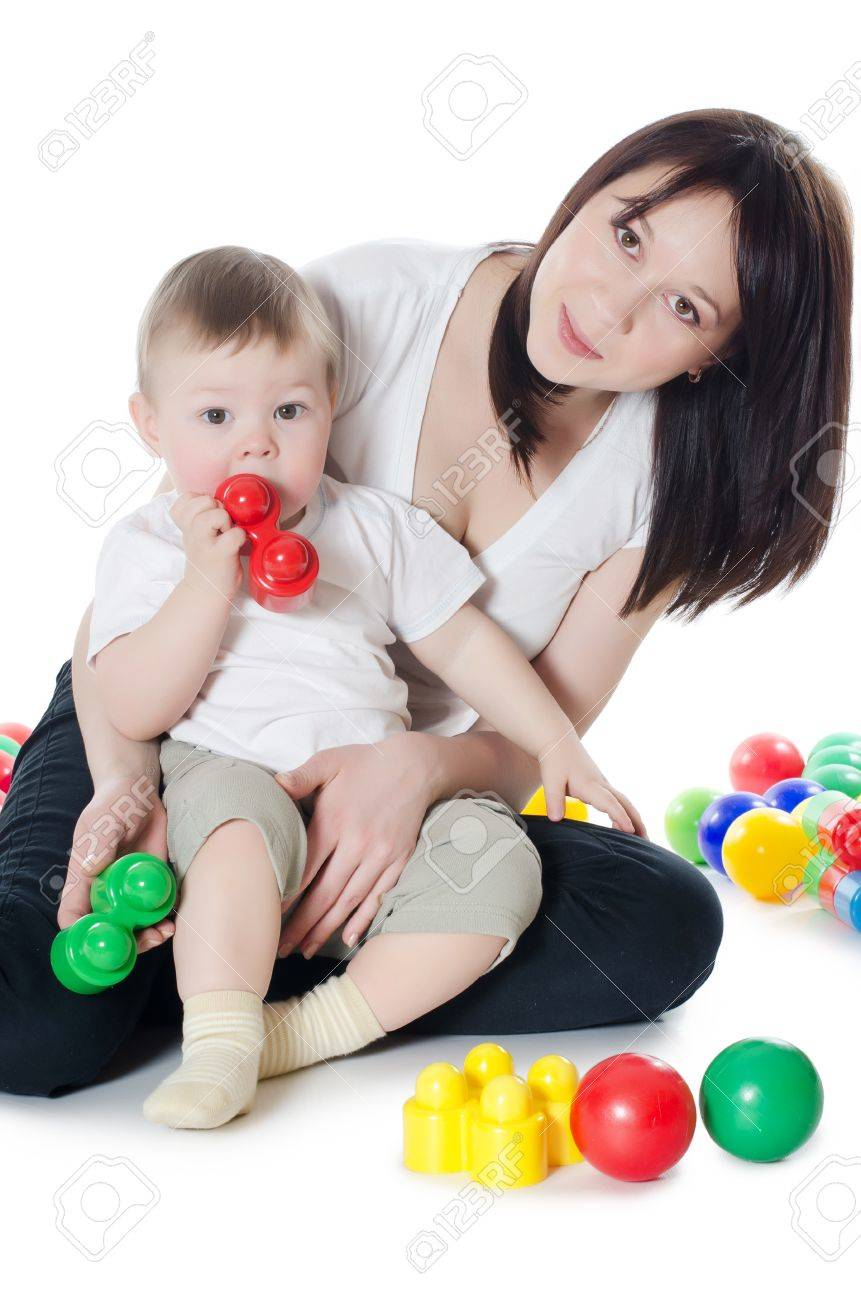 The little boy plays with mum isolated Stock Photo - 12134788
