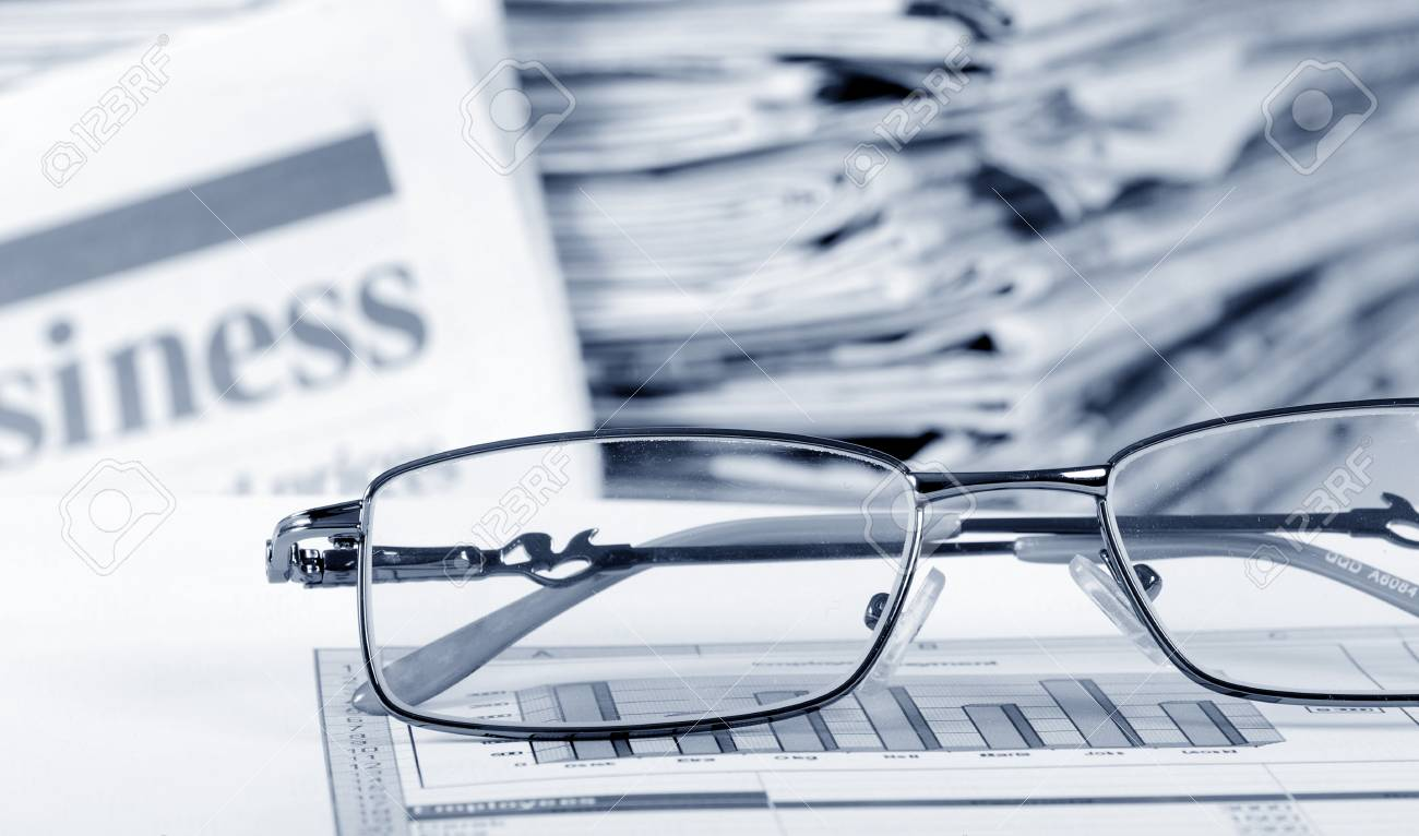 Business the newspaper with chart Stock Photo - 12458430