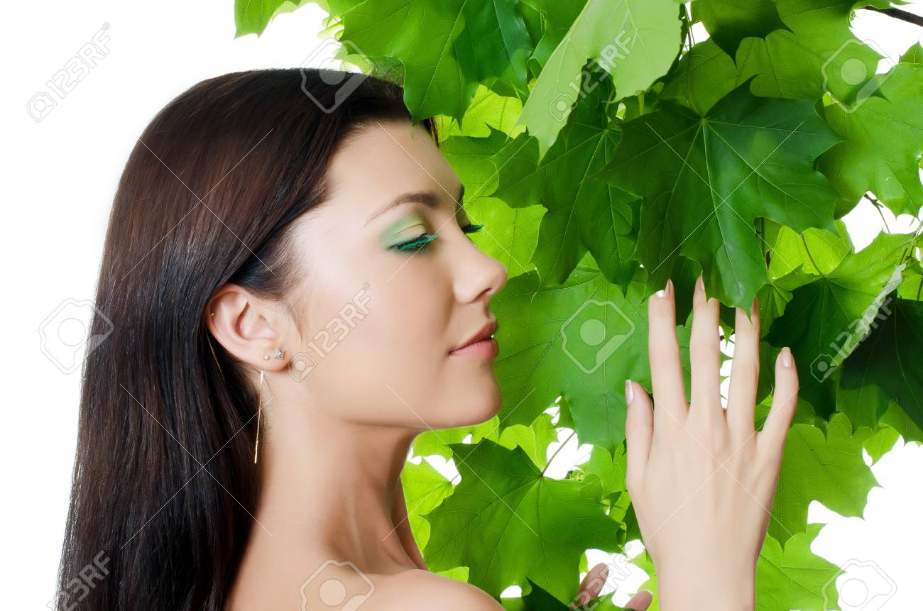 Beautiful woman with spring green leaves. Skincare Stock Photo - 13756634
