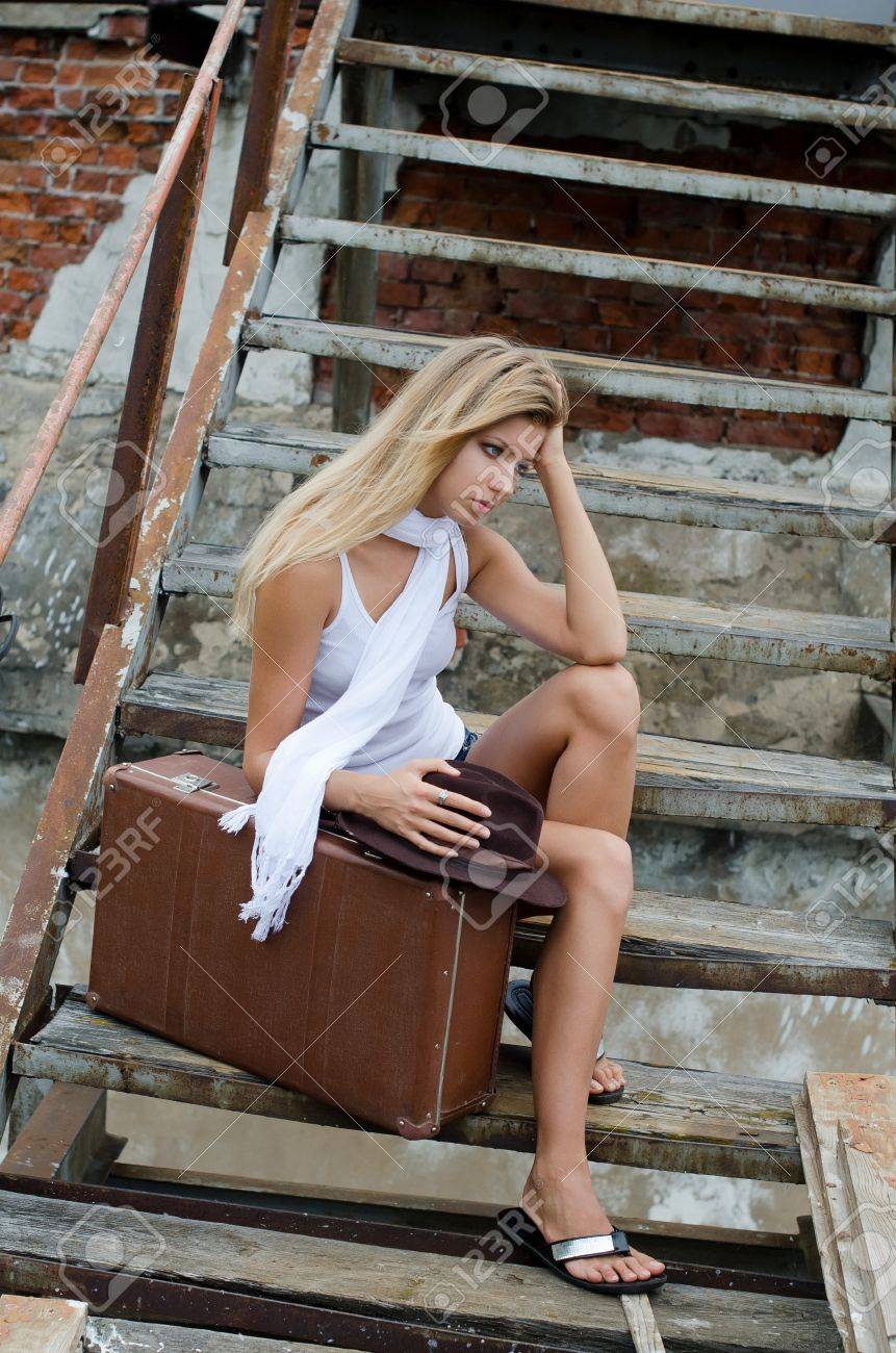 The woman with suitcase on old ladder Stock Photo - 14856842