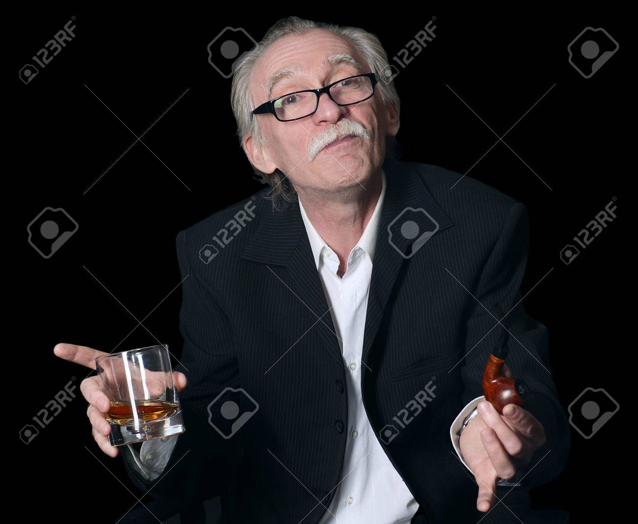 The elderly man with a glass of whisky on a black background Stock Photo - 19262182