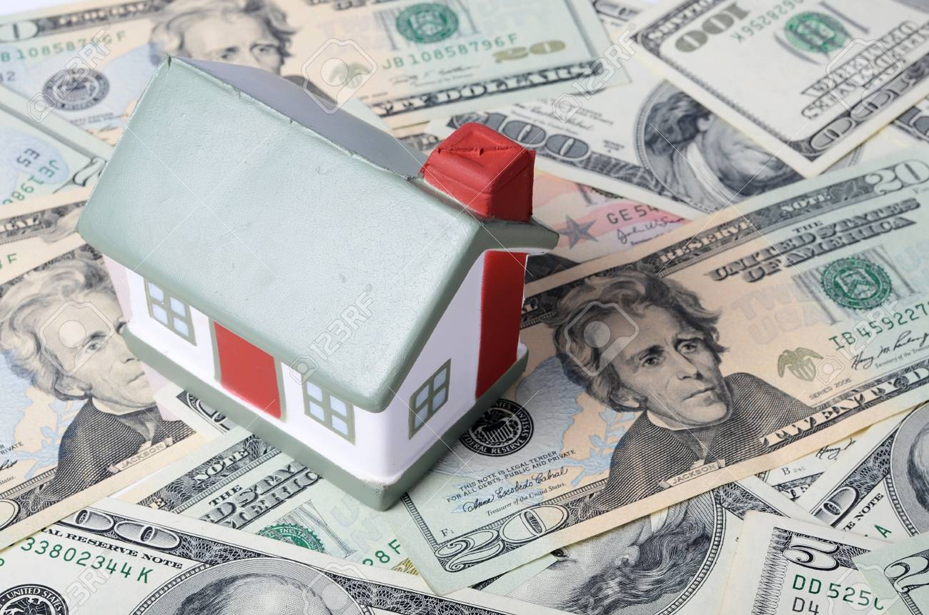 toy house for dollar banknotes as background Stock Photo - 21675222