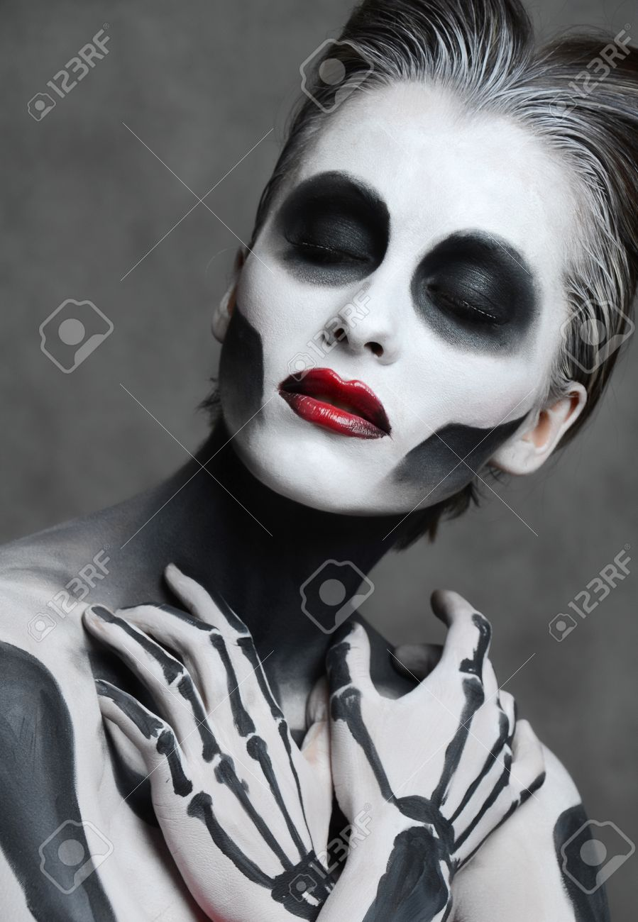 Young Woman With Dead Mask Skull Face Art. Halloween Face Stock ...