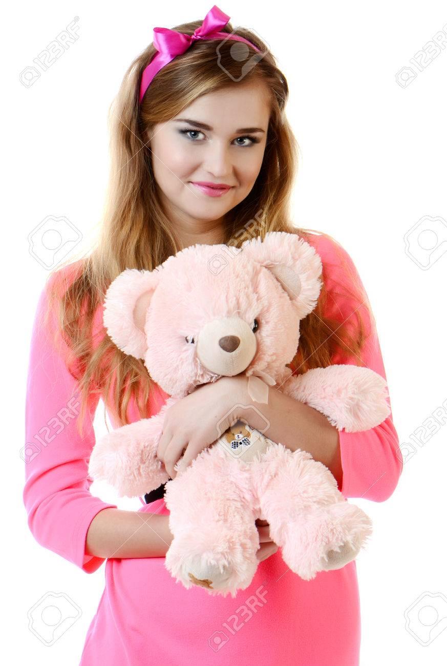 Bella Joven Sonriente En Un Vestido Rosa Con Un Oso De Peluche Fotos ...