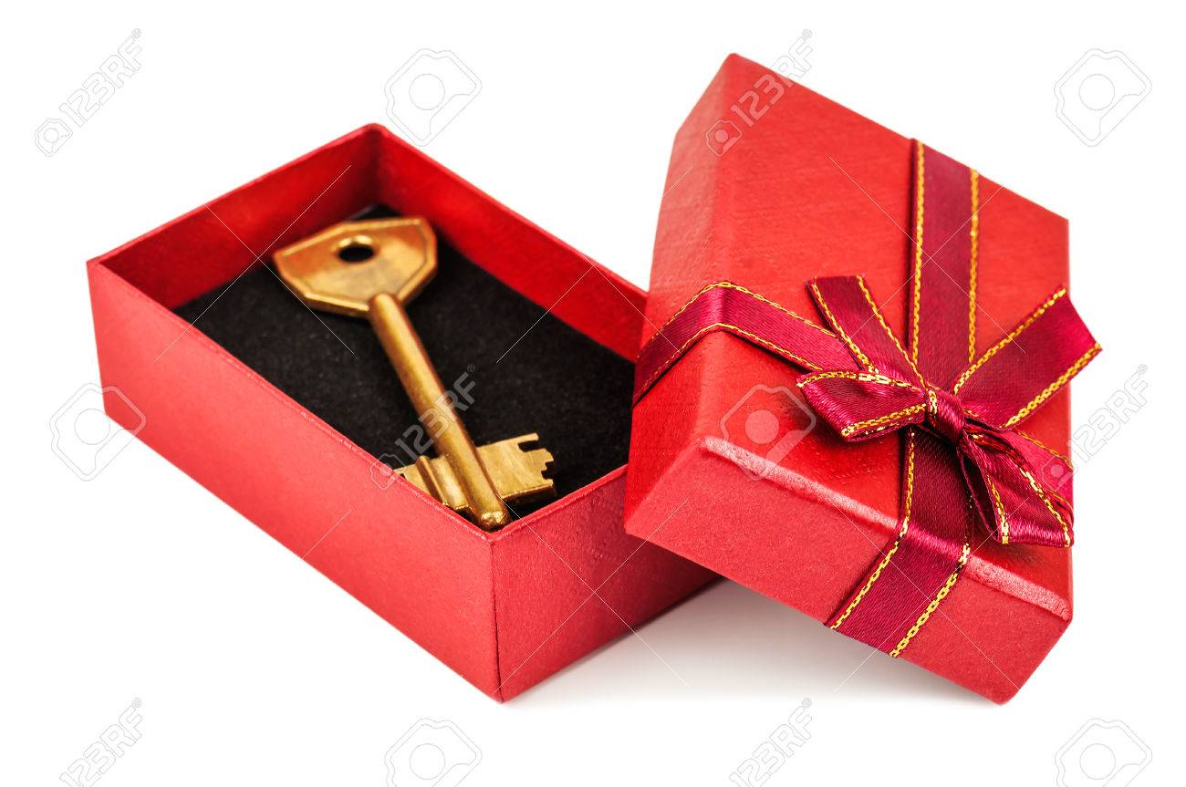 gold key in red gift box on white background - 49582981