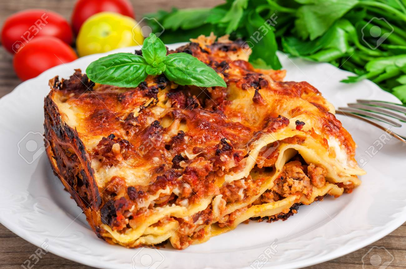 delicious italian lasagna with basil leaves - 70036928