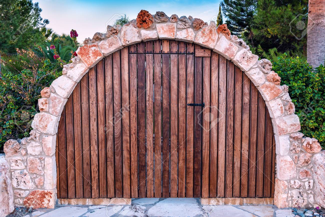 Beautiful Vintage And Brown Wooden Gate In The Form Of An Arch