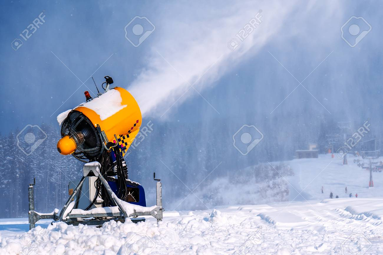 professional artificial snow machine cannon making snowflakes from water at ski resort - 90232119