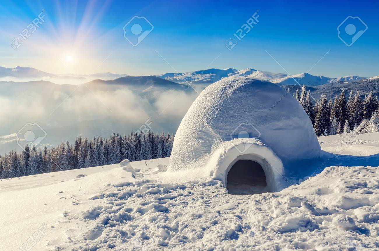 real snow igloo in the mountains under blue sky and sun - 90228441