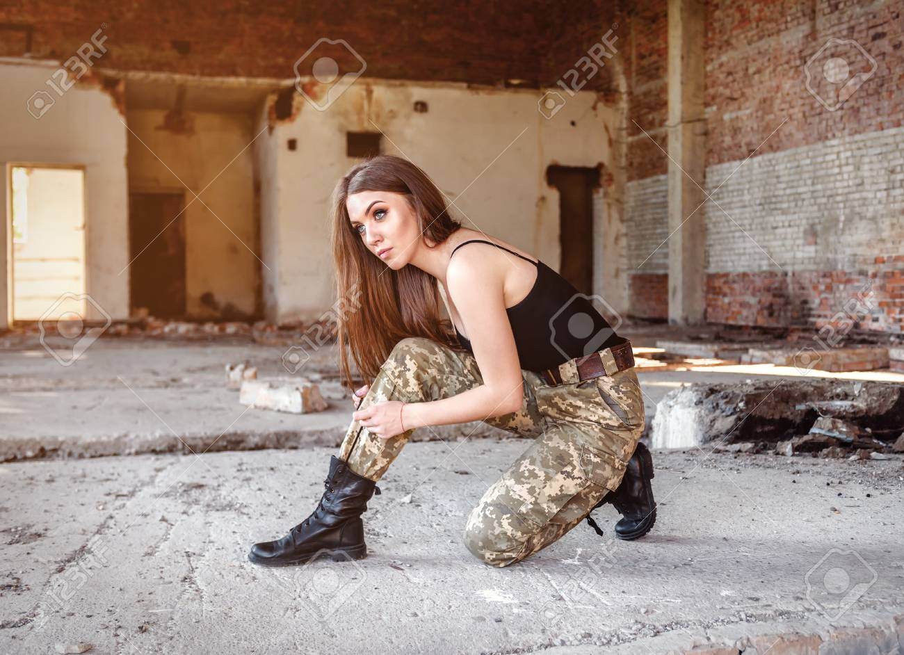 The Young Military Girl Tied Up Black Military Boots Stock Photo ...