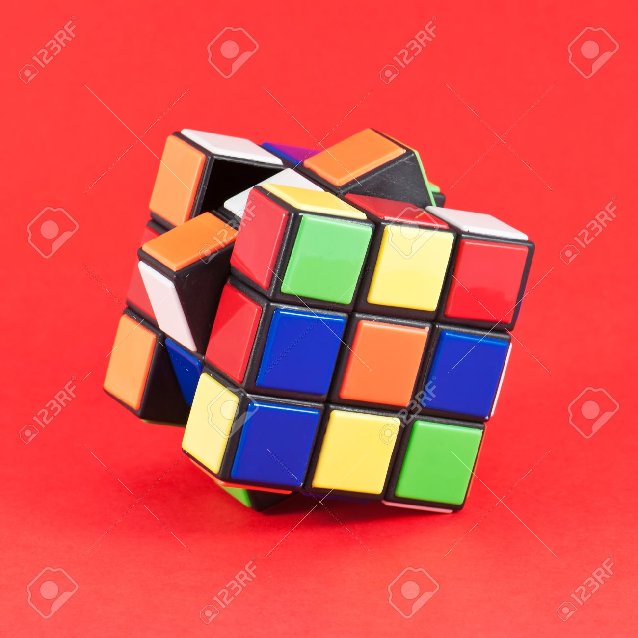In a classic Rubik's Cube, each of the six faces is covered by 9 stickers, among six solid colours (traditionally white, red, blue, orange, green, and yellow) Stock Photo - 12279937