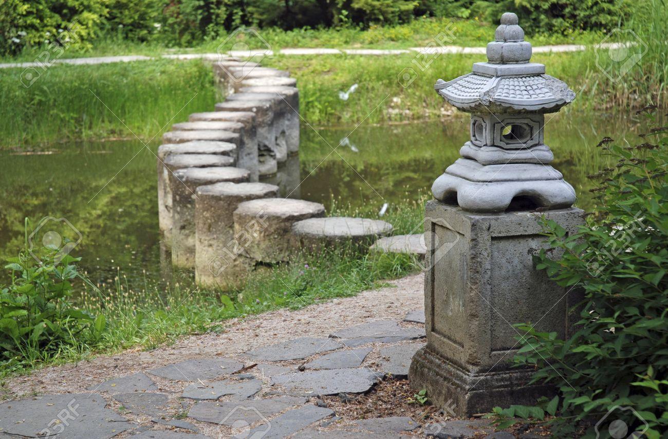 Charming Stone Pagoda In Green Garden: Decorative Stone Pagoda In Green Garden With  Stone Walkway Over