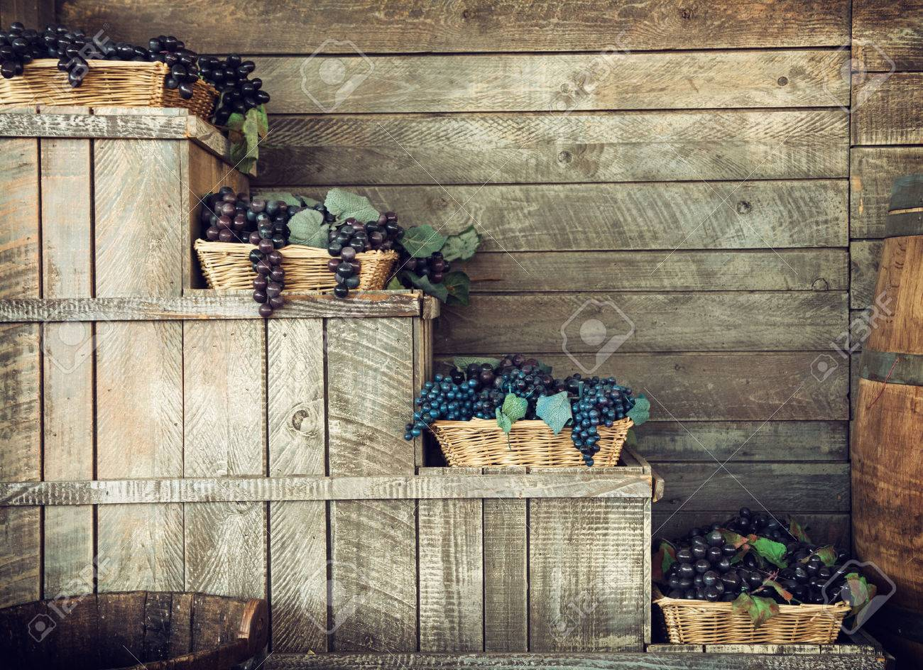 Various grapes in wicker baskets. Harvesting theme. Retro photo. - 45586867