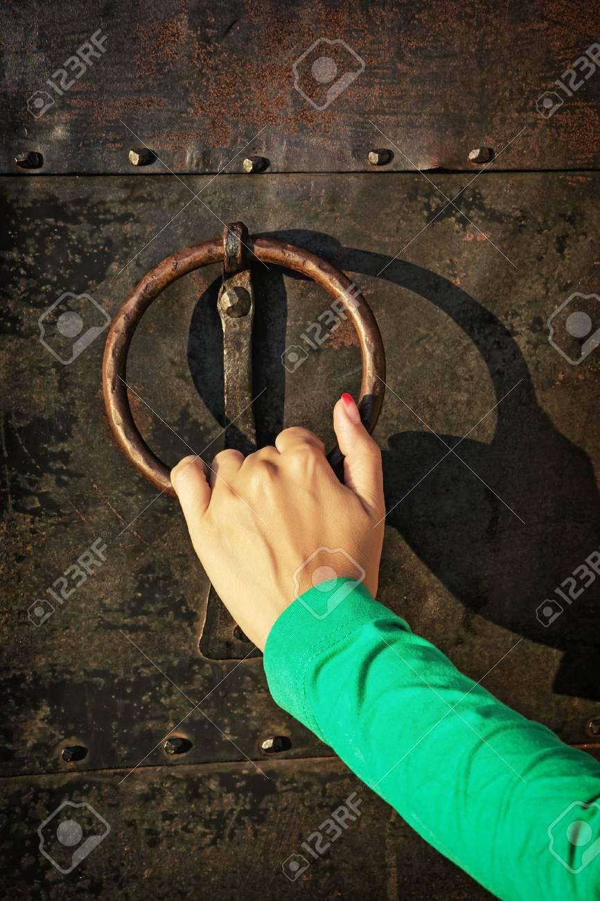 Vintage knocker door with woman's hand. - 46745107