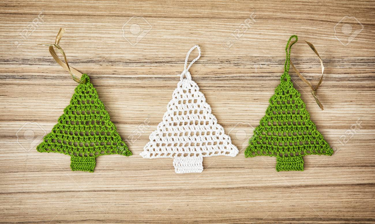 Crochet Christmas Tree.Green And White Crochet Christmas Tree On The Wooden Background