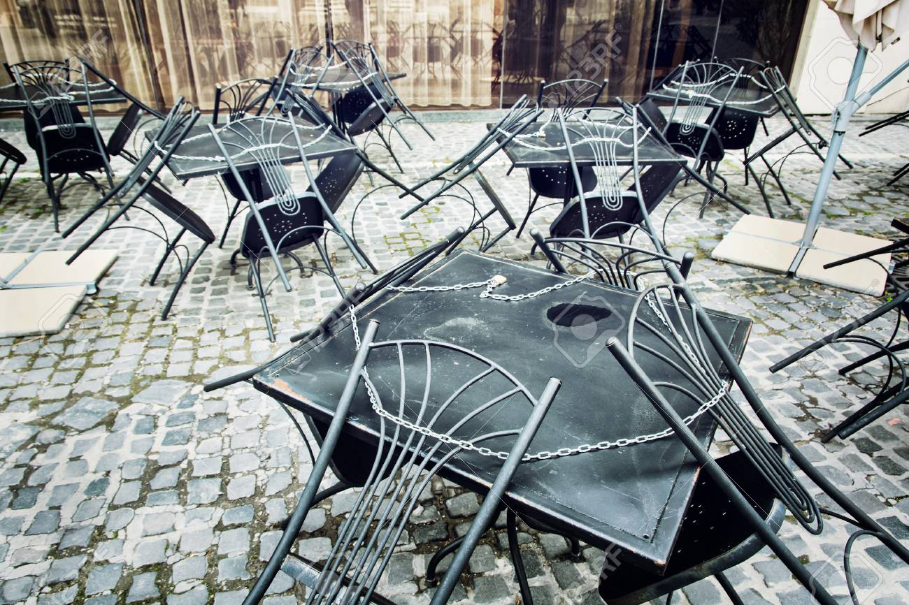 Set of metal garden chairs and tables in restaurant. It is closed. Outdoor street scene. - 48376780