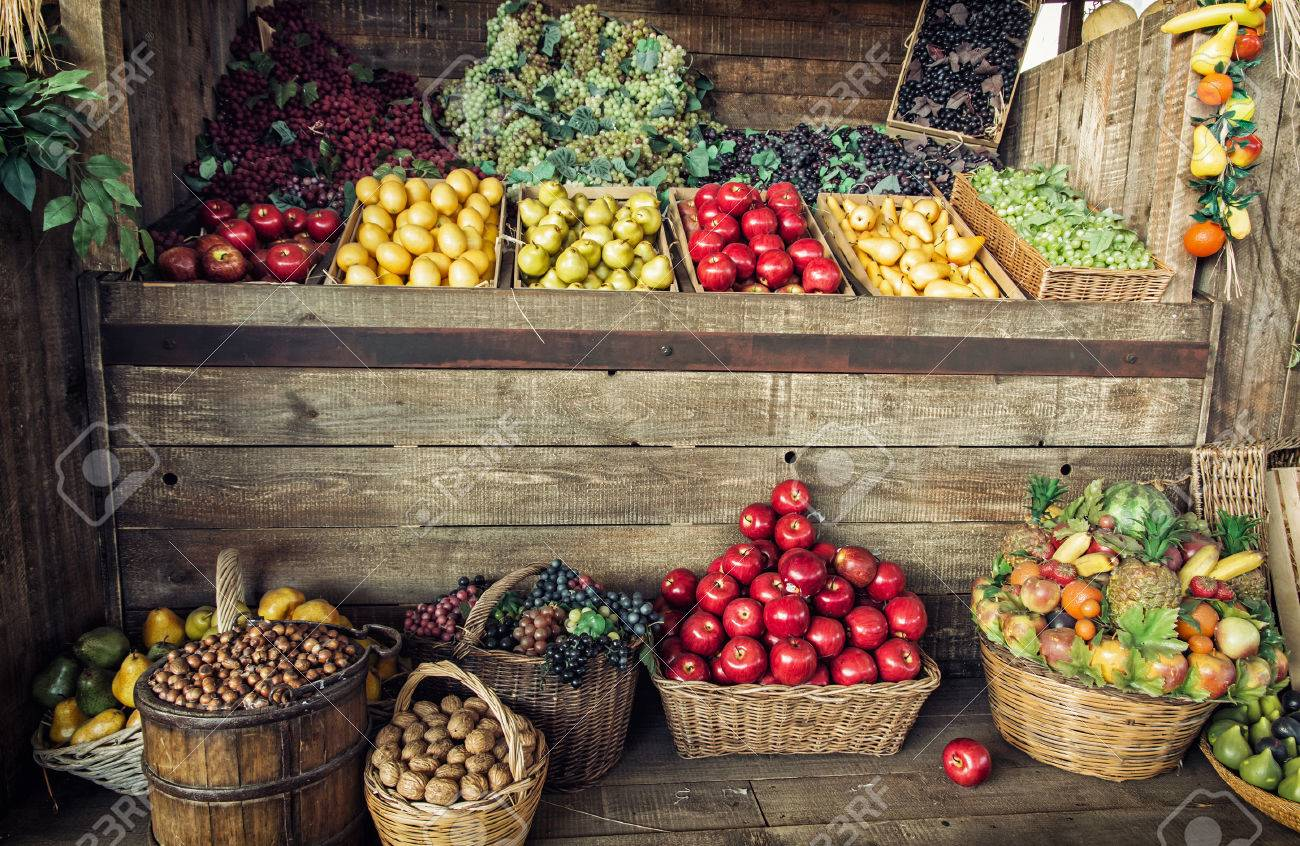 Various fresh fruits in the wicker baskets and crates. Fruit market. Healthy food. Vitamin bomb. - 56114645