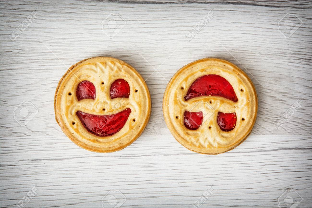 Two round biscuits smiling faces. Humorous sweet food. Tasty cookies. Good mood. Jam biscuits. - 58033488