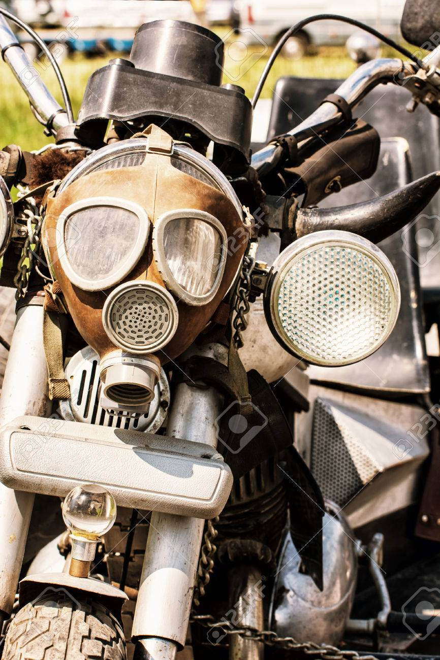 detail of veteran motorbike with symbolic gas mask. meeting bikers