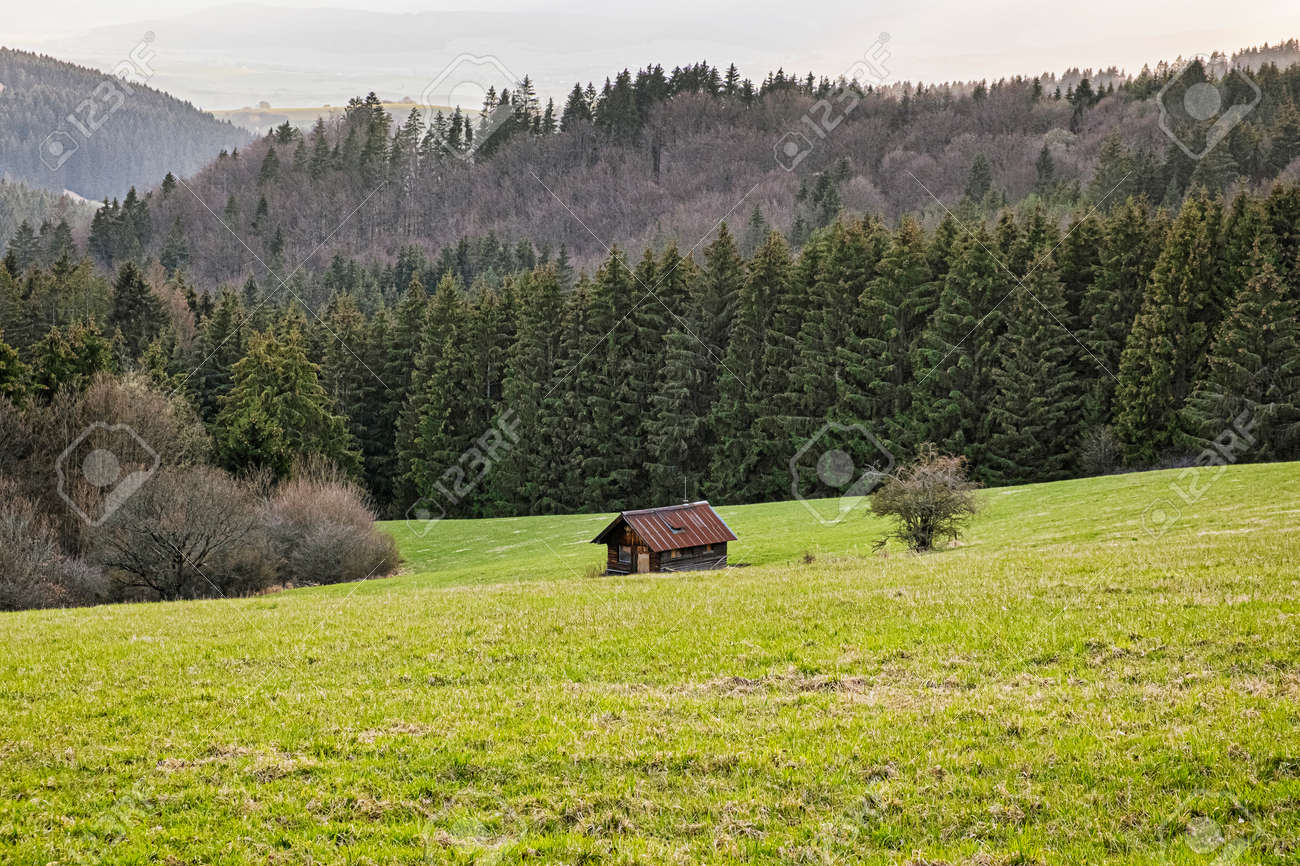 Wooden hut, Big Fatra mountains, Slovak republic. Seasonal natural scene. Travel destination. Hiking theme. - 169797900