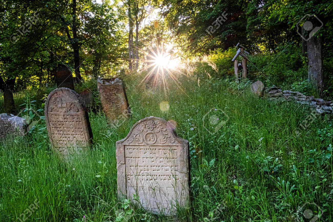Jewish cemetery with sunrays, Topola village, Slovak republic, Europe. Travel destination. - 170399884