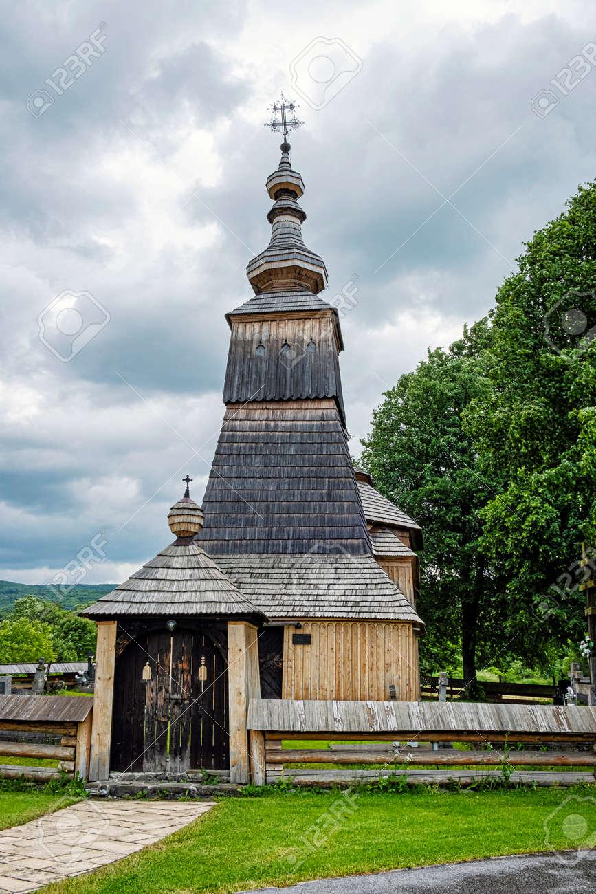 Wooden Greek Catholic Church St. Michael Archangel, Ladomirova village, Slovak republic, Europe. Travel destination. - 171586283