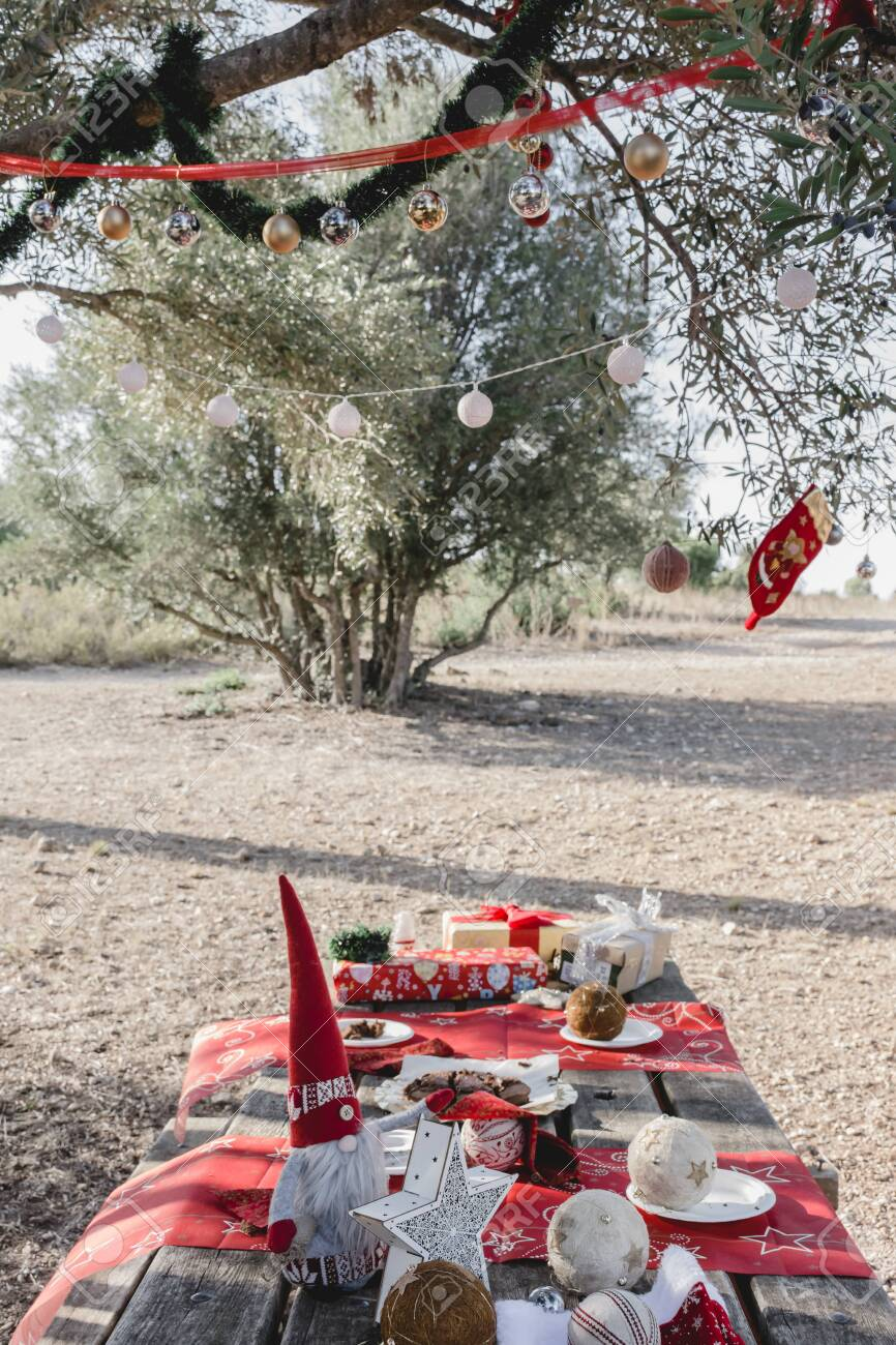 Christmas Decorations On A Picnic Table Under A Decorated Olive Stock Photo Picture And Royalty Free Image Image 156284981