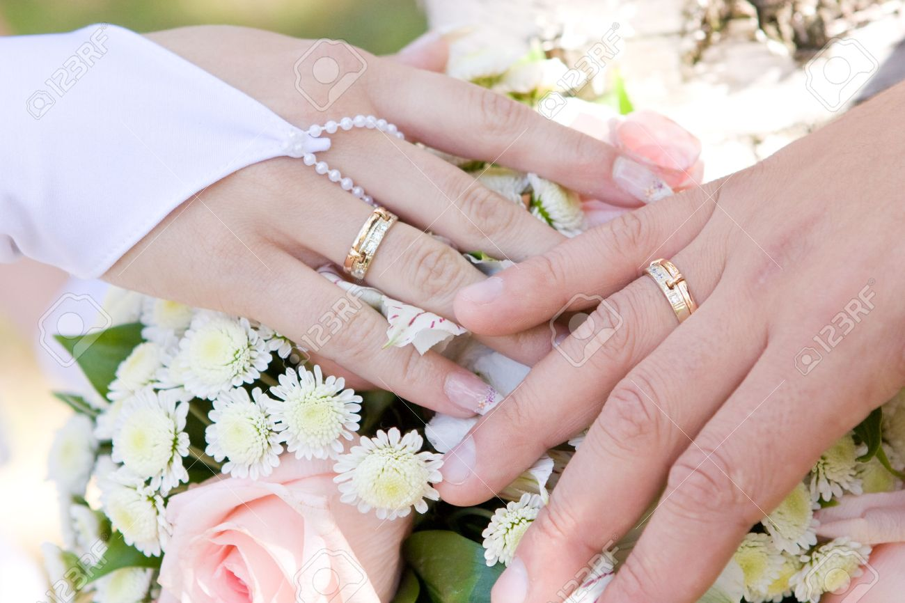 A Hand Of A Groom And A Hand Of The Bride With Wedding Rings.. Stock ...