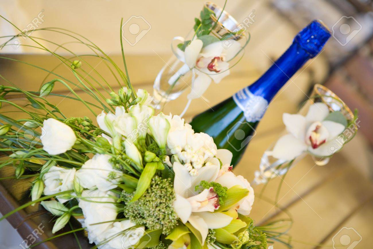 bottle of champagne and two glasses on the table Stock Photo - 3200030