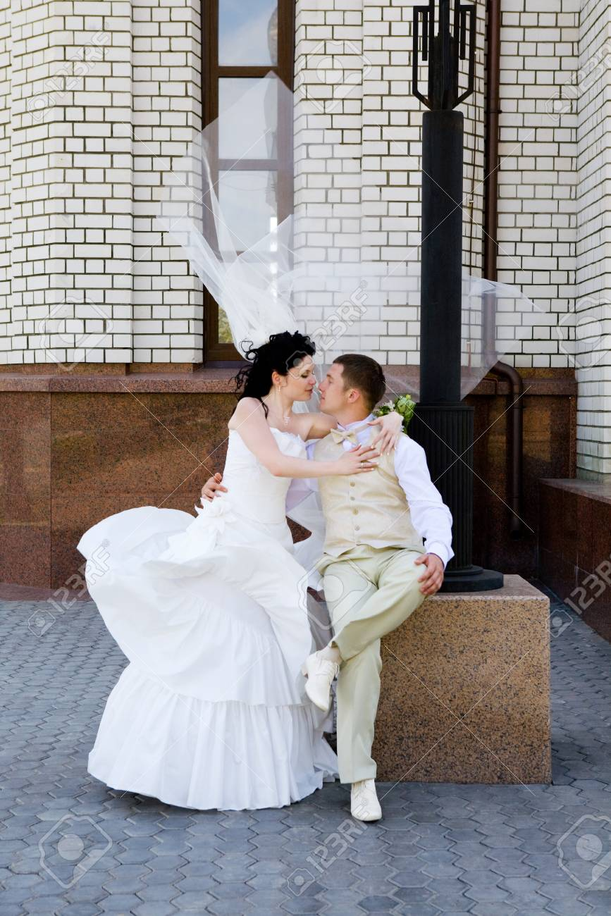 bride and groom near the wall Stock Photo - 4135139