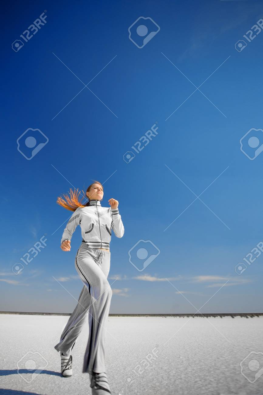 running girl on the white salt land Stock Photo - 6612586