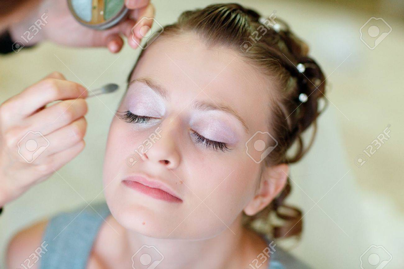 girl applying wedding make-up by professional make-up artist Stock Photo - 13198879