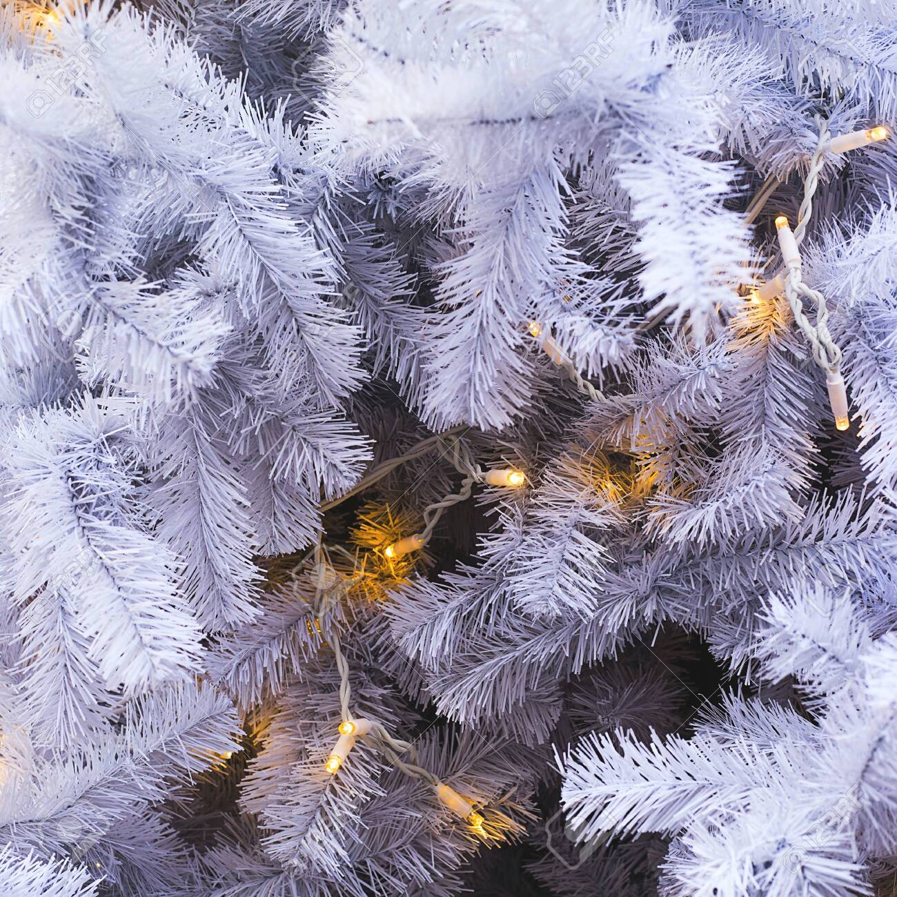 White Branches Of A Fake Plastic Christmas Tree With Lights As Stock Photo Picture And Royalty Free Image Image 137565635