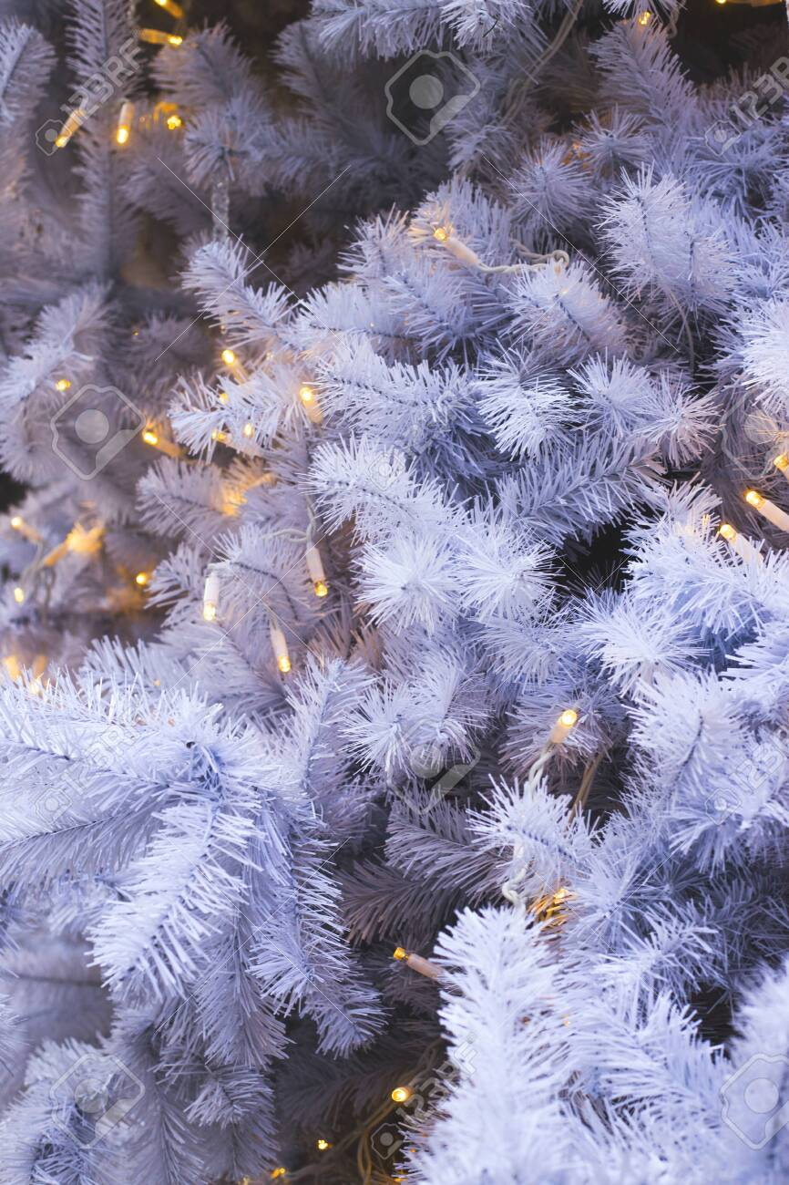 White Branches Of A Fake Plastic Christmas Tree With Lights As Stock Photo Picture And Royalty Free Image Image 137962756