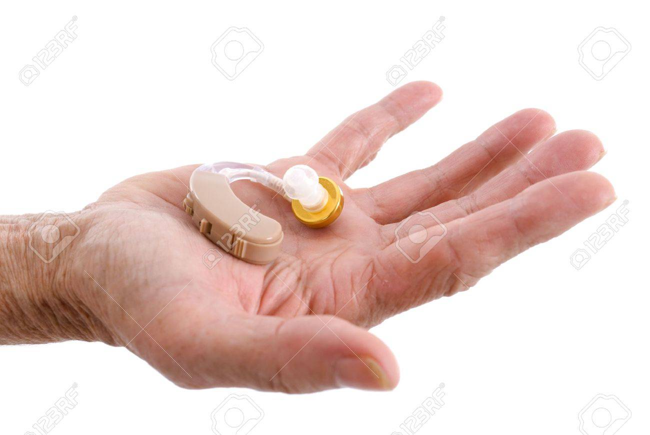Hands showing a Hearing aid on white background . Stock Photo - 5080158