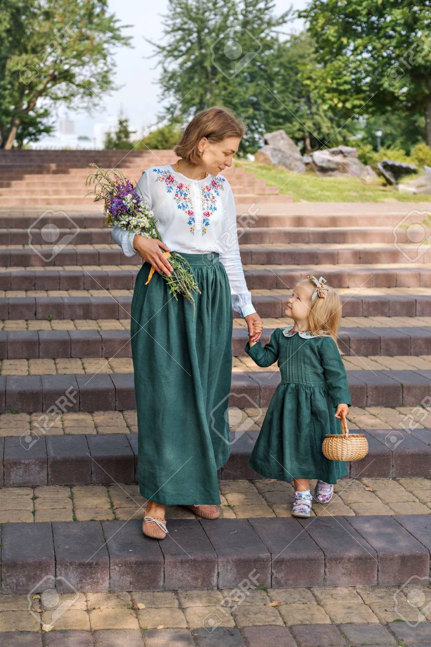 Family mom with daughter in vintage retro style linen dresses