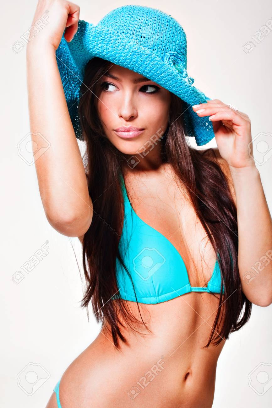 young brunette in blue bikini and hat Stock Photo - 4591137