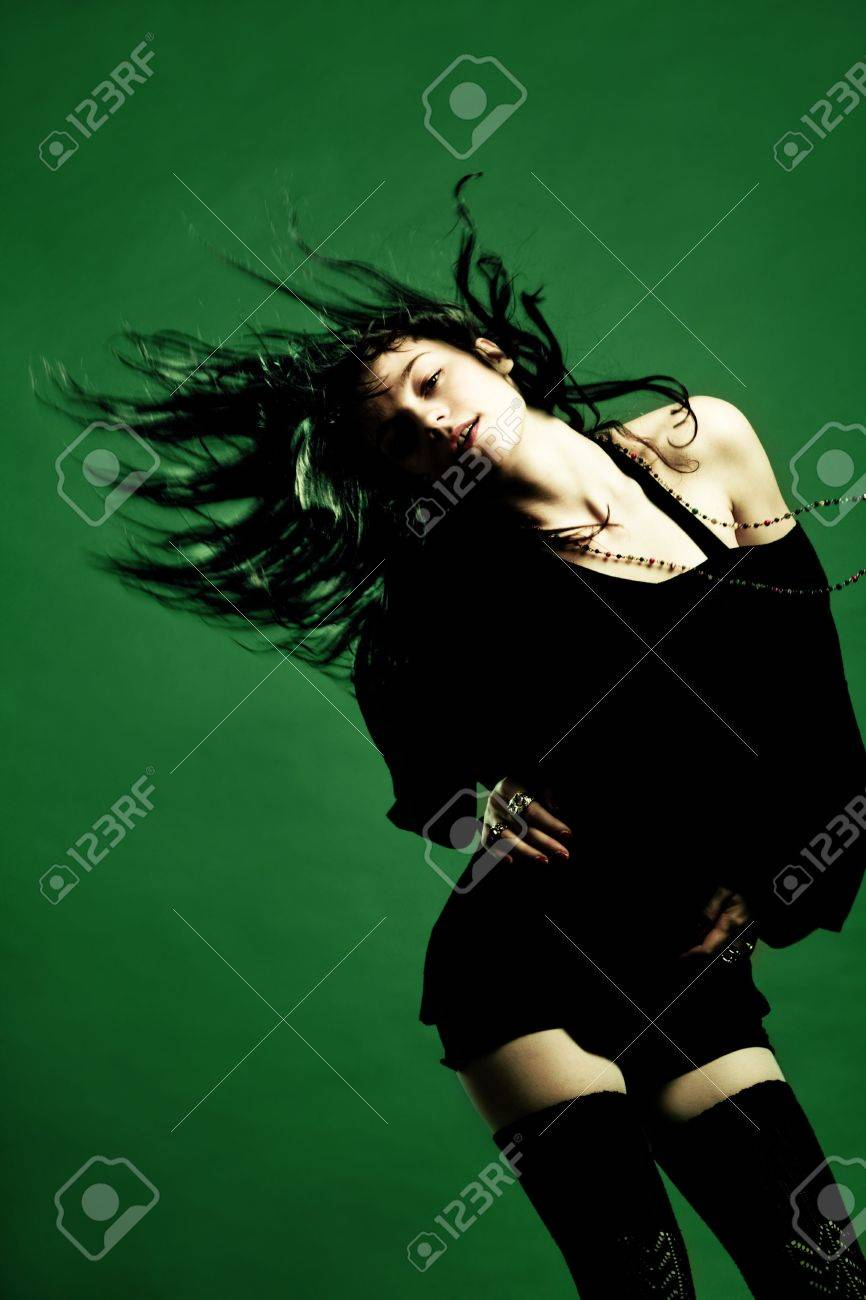 young woman dancing, studio shot Stock Photo - 6156347