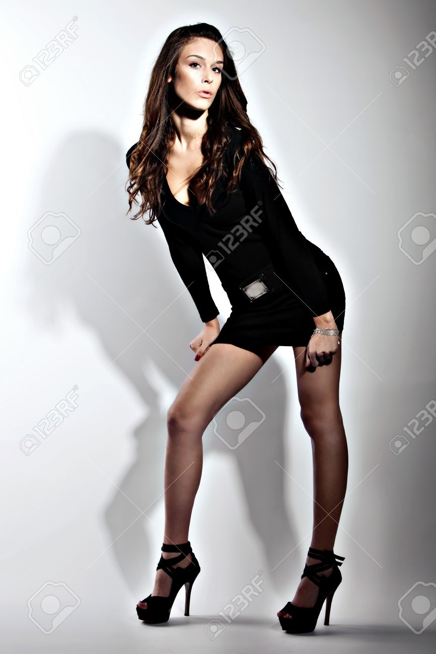 3ff92f5b3bc7 Pretty Young Woman In Short Black Dress On High Heels