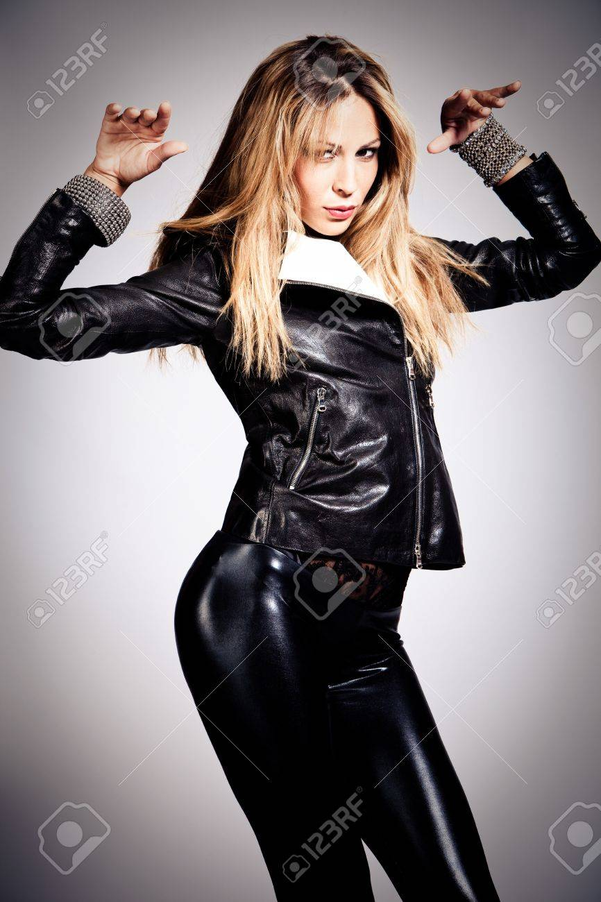 young blond woman in black leather, studio shot Stock Photo - 7832575