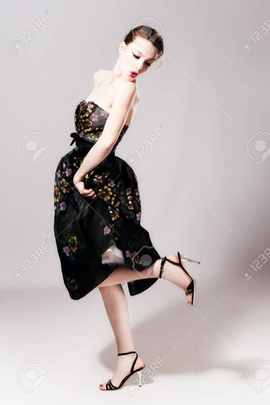 young woman in elegant high fashion dress, studio shot, full body shot Stock Photo - 8599713
