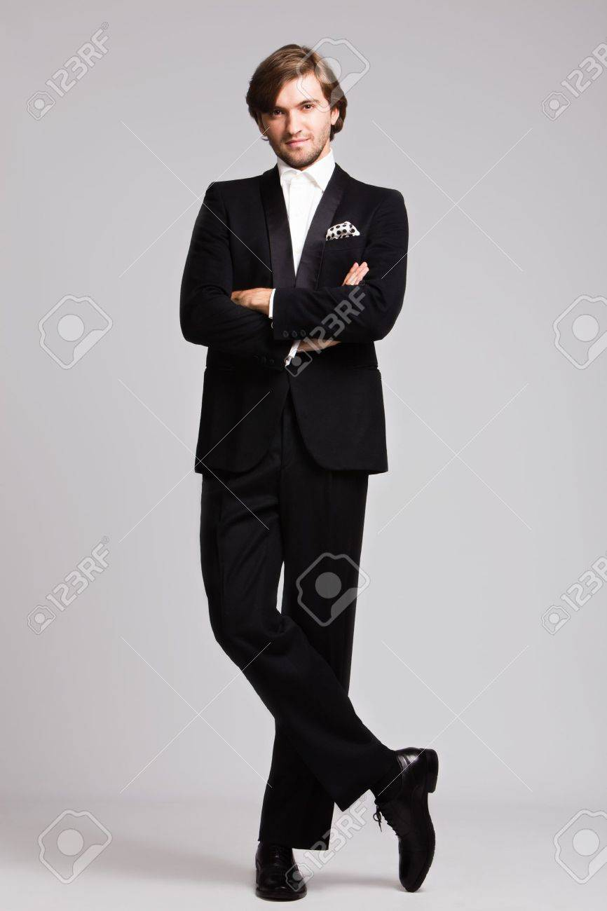 reasonably priced shades of women elegant young man in black tuxedo, full body shot, studio shot