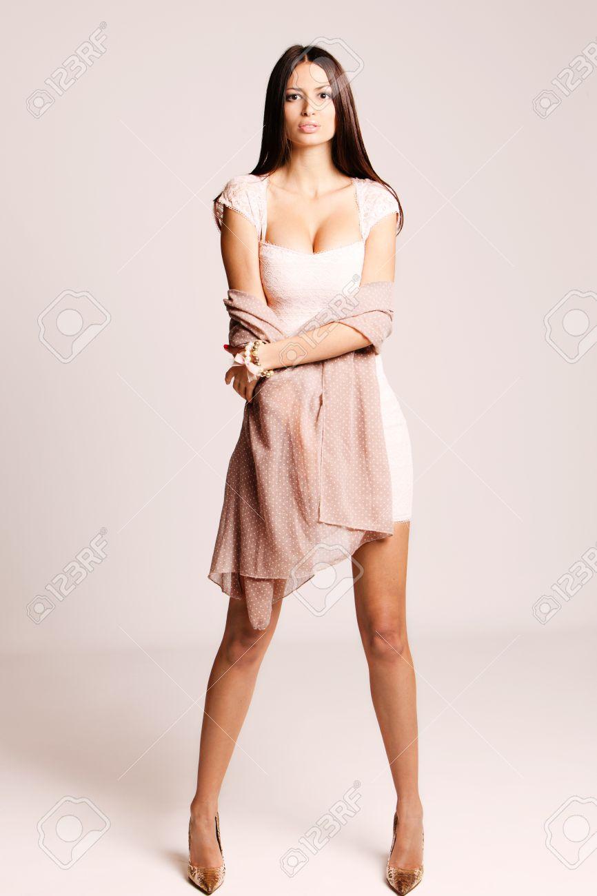 Elegant Young Woman In Short Dress And High Heels Studio Shot