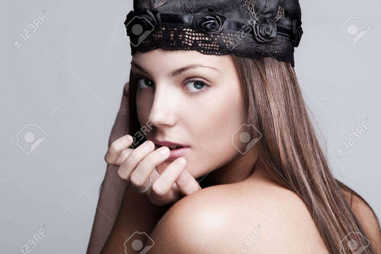 young woman beauty portrait wearing satin cap with embroidery Standard-Bild - 15041910