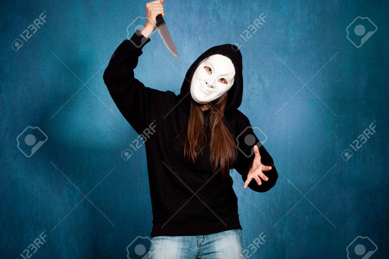 Halloween Girl With White Mask And Big Knife Front View Stock ...